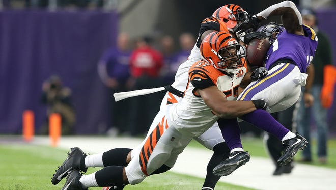 Cincinnati Bengals outside linebacker Vincent Rey (57) and Cincinnati Bengals strong safety Shawn Williams (36) tackled Minnesota Vikings running back Jerick McKinnon (21) in the second quarter during the Week 15 NFL game between the Cincinnati Bengals and the Minnesota Vikings, Sunday, Dec. 17, 2017, at U.S. Bank Stadium in Minneapolis, Minnesota. Minnesota leads 24-0 at the half.