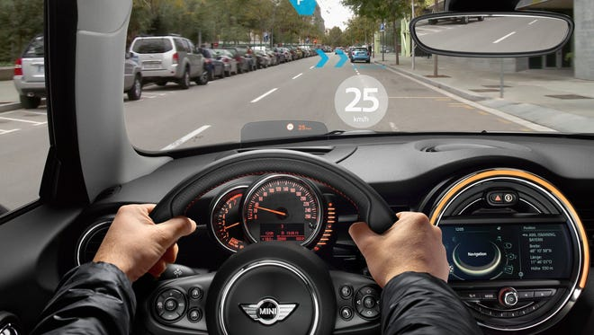 Mini Augmented Vision consists of a pair of large goggle-style glasses that provide its wearer with heads-up display information ranging from vehicle speed to the ability to see-through panels thanks to exterior cameras.