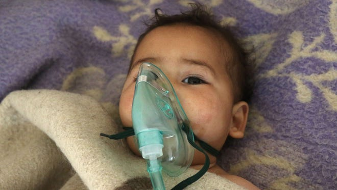 A Syrian child receives treatment following a suspected toxic gas attack in Khan Sheikhoun, a rebel-held town in the northwestern Syrian Idlib province, on April 4, 2017.