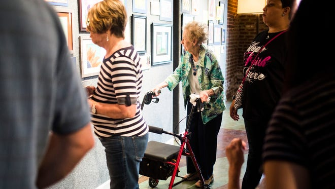 People mill around an art exhibit of original watercolors created by local senior citizens through a program called Senior Studio on Tuesday, September 27, 2016 at the Anderson Arts Center.