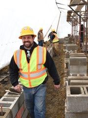 Steve Agazzi, owner of Agazzi Development, walks inside