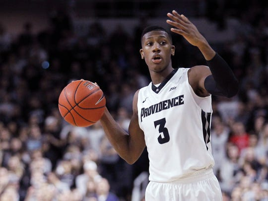 This Feb. 13, 2016 photo shows Providence guard Kris Dunn (3) during the first half of an NCAA college basketball game against Georgetown in Providence, R.I.