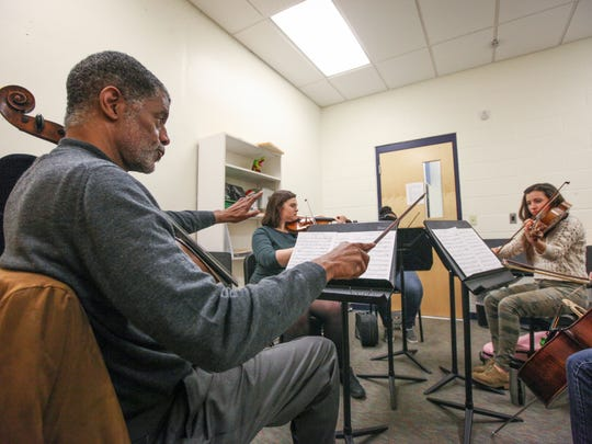 Norman Johns, CSO assistant principal cellist,  watches over the technique of his students during class at the School for Creative and Performing Arts. Johns inspires minority students to continue to play their instruments to achieve higher goals for themselves.