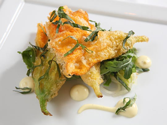Sanford Restaurant in Milwaukee offers fried squash blossoms with cucumber, kohlrabi and antique apple.