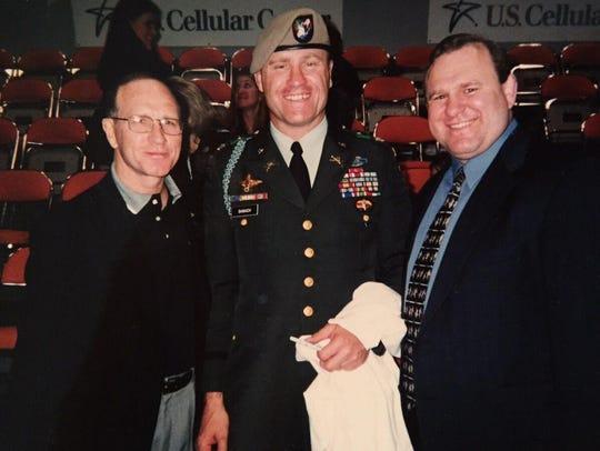 Dan Gable, left, Steve Banach, center, and Ed Banach