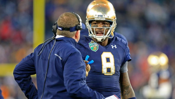 Notre Dame quarterback Malik Zaire (8) talks with coach