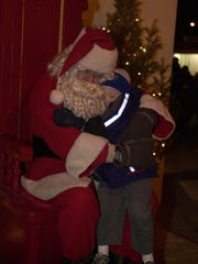 Santa Claus visits The Office Bar in Vaughn during the annual Christmas Party and Hayride Saturday, Dec. 16.