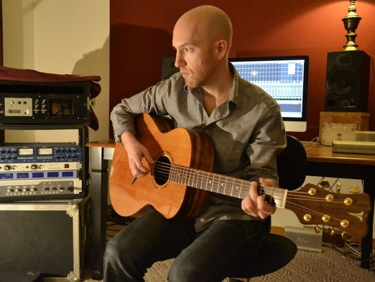 Danen Kane plays his Vesper acoustic guitar at his