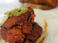 Prince's Hot Chicken Shack serves crispy, blistering greatness on a cottony slice of white bread, cooled with pickle coins.