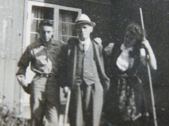 Bill Andrews, left, of Brockport, with Norwegian photographer Anders Beer Wilse, center, and Wilse's granddaughter Helene Wilse in Norway in 1947. Andrews was 17 at the time.