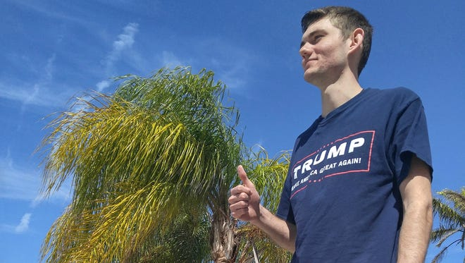 Devin Hill, an 18-year-old first-time voter, said he supports Donald Trump.