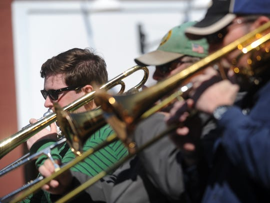 Members of the CommUnity Band perform during the 2nd annual O'Nancock St. Patrick's Parade on Sunday, March 15, 2015 in Onancock, Va.