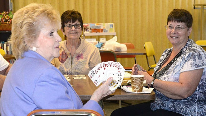 A group of ladies enjoys a game of Pinochle at the Vineland Senior Center.