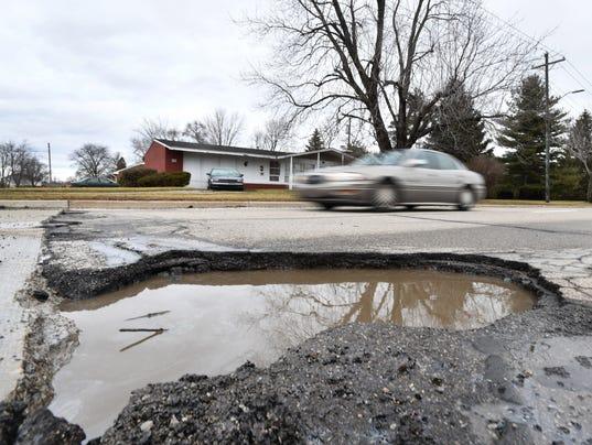 636548247982952503-2018-0221-dm-pothole1.jpg