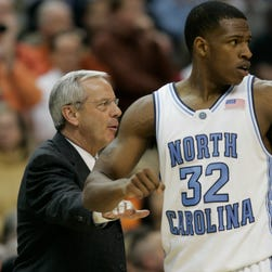UNC coach Roy Williams with former player Rashad McCants.