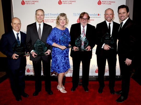 Awards recipients Scott Hamilton; Joseph Smith, M.D.; Janet Miller; Rod Essig; Louis Messina; and Charles Esten pose together during T.J. Martell Foundation 9th Annual Nashville Honors Gala at Omni Hotel on Feb. 27, 2017.