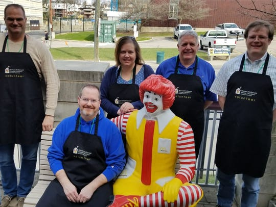 Centric Consulting employees volunteering at the Ronald