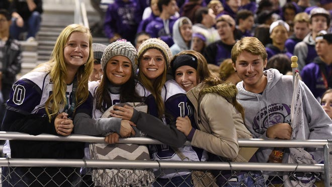 Spanish Springs students watch the Cougars during homecoming on Oct. 17.