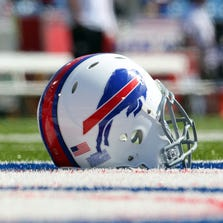 Sept. 16, 2012; Orchard Park, NY, USA;  A general view of a helmet used by the Buffalo Bills players before a game against the Kansas City Chiefs at Ralph Wilson Stadium.  Mandatory Credit: Timothy T. Ludwig-US PRESSWIRE