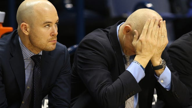The Enquirer/Cara Owsley Xavier assistant coach Luke Murray, left, head coach Chris Mack react during the Musketeers? 73-57 loss. Mack must figure out how to handle the injured Trevon Blueitt. Xavier assistant coach Luke Murray, left, head coach Chris Mack react as the Musketeers loose to Villanova  Saturday February 11, 2017 at the Cintas Center. Xavier lost 73-57.