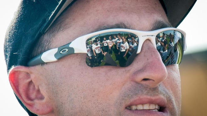South Plainfield girls visited Middletown North to play an NJSIAA North 2, Group III Tournament semifinal softball game. North coach Marc Rosner talks to his team (reflected in his sunglasses) just before the game. Game was played on Tuesday, May 31, 2016. / Russ DeSantis for the Asbury Park Press / Slug:ASB 0601 NJSIAA Softball Gamer