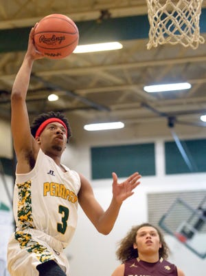 Pennfield's Ronald Jamierson (3) goes for two points during game action Friday night.