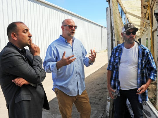 From left, Michael Bitar, Gavin Kogan and Tod Williamson outside one of the Riverview Farms cannabis greenhouses in Salinas, CA.