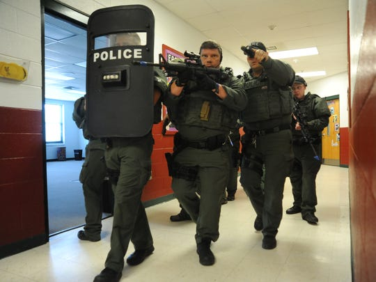 A team of specially trained officers participates in a drill inside Black Mountain Elementary on June 7.