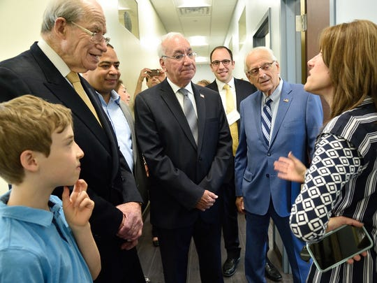 Michele Wellikoff, right, the agency's director of business development, gives a tour of the facility to Herb Klein, the philanthropist and former congressman for whom the building is named; Passaic Mayor Hector Lora; Clifton Mayor James Anzaldi; and U.S. Rep. Bill Pascrell.