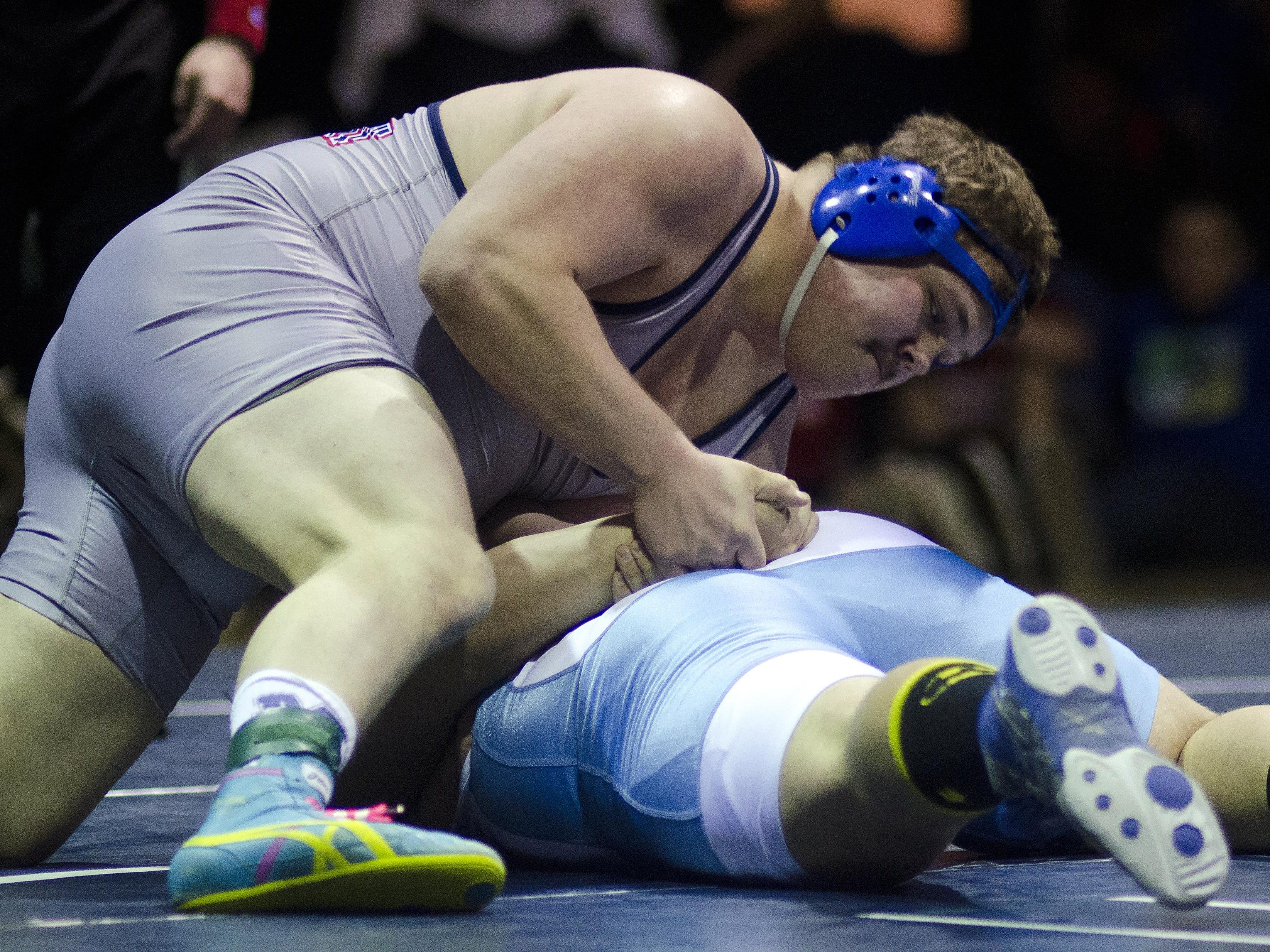Mount Anthony's Jesse Webb (top) controls the action against Mount Mansfield's Dalton Hallock in the 285-pound state championship match Saturday night in Bennington. Webb, the state's all-time winningest wrestler, won with a first-period pin to claim his fourth state crown. AUSTIN DANFORTH/FREE PRESS