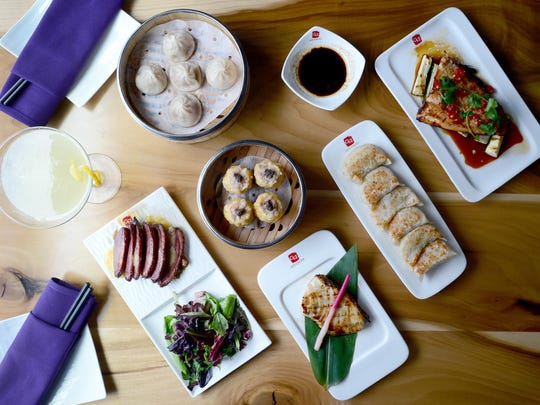 Dishes at at Red Ginger Dim Sum and Tapas include a Yuzu Sake Drop martini, smoked duck breast, Shanghai-style pork dumplings, black truffle Shu Mai, grilled Chilean sea bass, pan fried vegetable dumplings, and Szechuan-style grilled mountain trout.