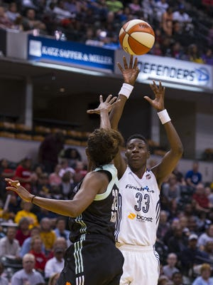 The Fever's Natasha Howard (33), shown putting up a shot  during a game at Bankers Life Fieldhouse, is heir apparent to Tamika Catchings.