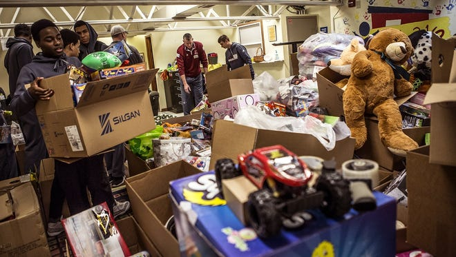 Local organizations, such as the Salvation Army and Newark Division of Police, are still in need of toys and donations to help local families in need. Here, volunteers prepare boxes of toys to be distributed by the Salvation Army in 2015.