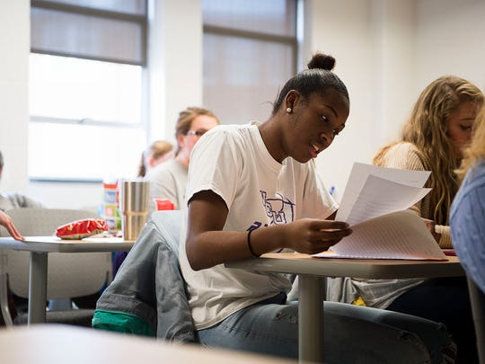 WCU student and basketball player Sherae Bonner reviews notes during her social studies for elementary education class Dec. 6.