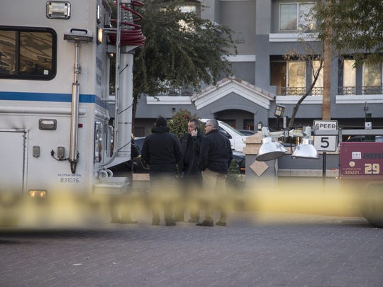 A woman and her two children were killed and a police officer was injured in a series of Christmas Day shootings at a central Phoenix apartment complex, police said.