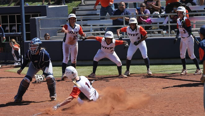 UTEP freshman Lindsey Sokoloski slides in home to complete an inside-the-park grand slam Saturday against UTSA.