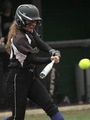 Clear Fork's Courtney Palmer makes contact with the
