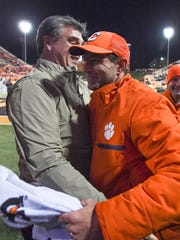 Clemson AD Dan Radakovich and coach Dabo Swinney have celebrated six consecutive seasons with 10 or more wins