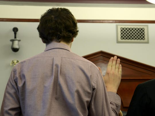Kendle Burgos, 15, is sworn under oath before submitting guilty pleas to nine counts of sexual abuse against minors in February, 2017. (TRIBUNE PHOTO/SEABORN LARSON)