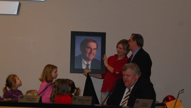 Long-time Erlanger city attorney Frank Wichmann was presented with a portrait at a February 2009 council meeting which the city named a room the Wichmann Conference Room.