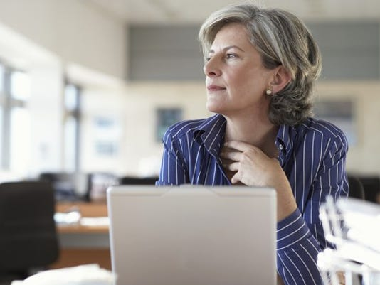mature-woman-on-laptop-thinking-and-looking-out-window_large.jpg