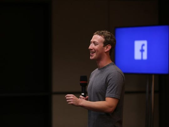 Mark Zuckerberg answering questions at a town hall.