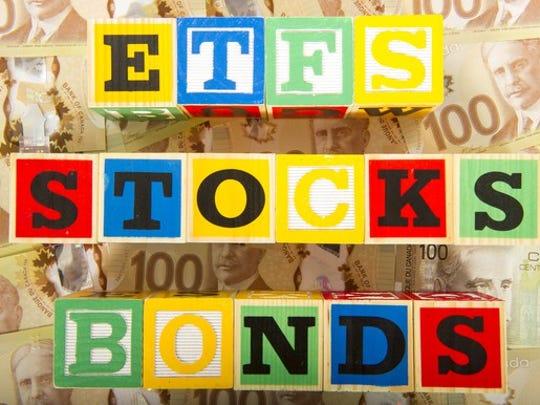 "Building blocks arranged to read ""ETFS"" ""STOCKS"" and ""BONDS"""
