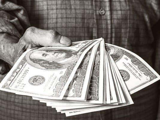 senior-holding-cash-retirement-distribution-getty_large.jpg