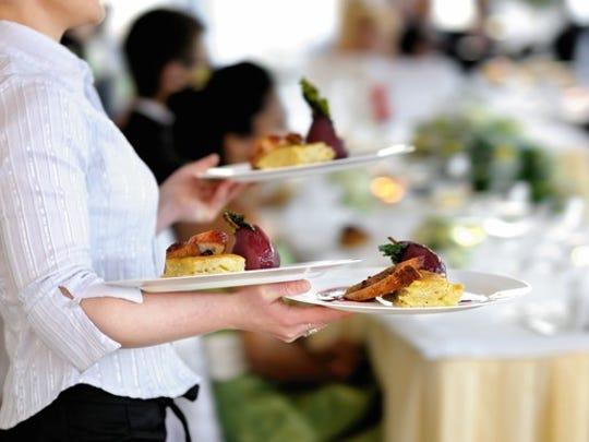 Waitress carrying plates