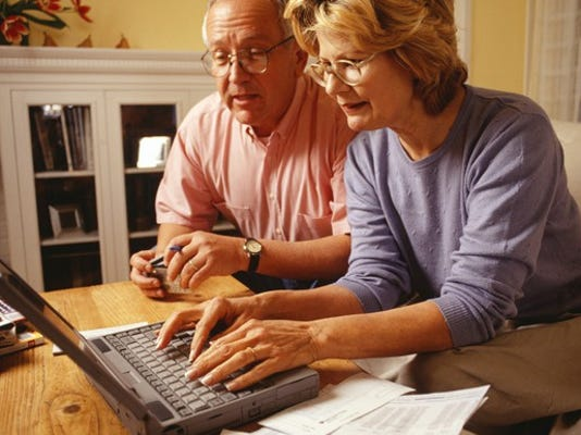 senior-couple-using-laptop-and-credit-cards_large.jpg