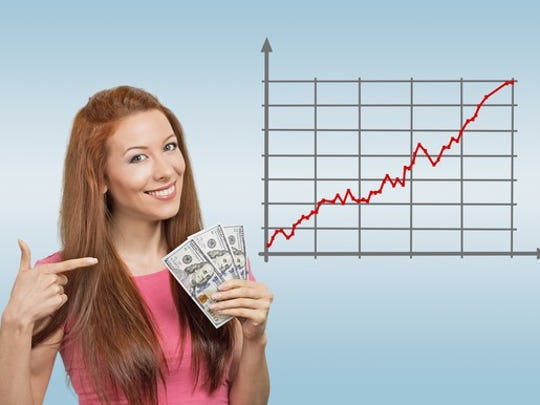 A woman holding a stack of cash next to a rising stock chart.