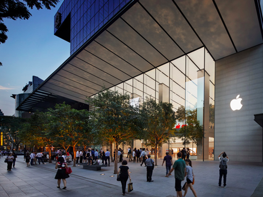 People shown walking into Apple's store in Singapore