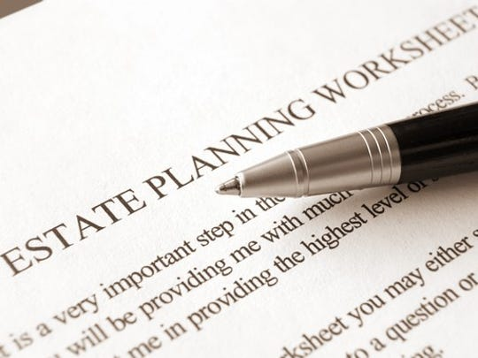Paper labeled estate planning worksheet with instructions, and a pen on top.