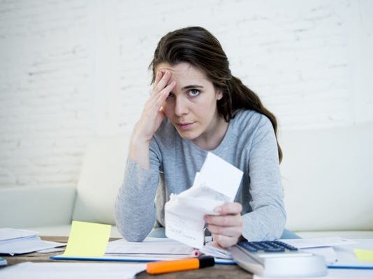 woman-stressed-about-bills_gettyimages-540503334_large.jpg